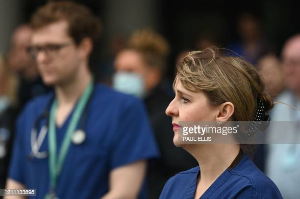 Staff pause for a minute's silence to honour UK key workers, including NHS staff, health and social care workers, who have died during the...