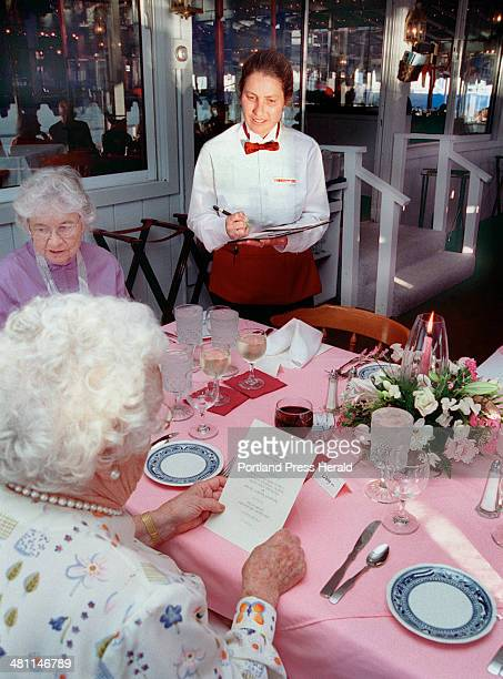 Staff Photo by David MacDonald, Fri, Jun 23, 2000: Cassie Greenleaf takes dinner orders at her night job as a server at the Rocktide Inn in Boothbay...