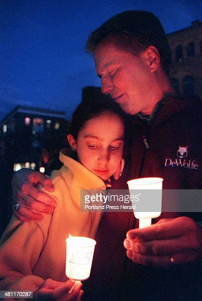 Staff Photo by David MacDonald Fri Oct 26 2001 David Shedd of Portland holds his daughter Allie during a candlelight vigil for Amy St Laurent in...