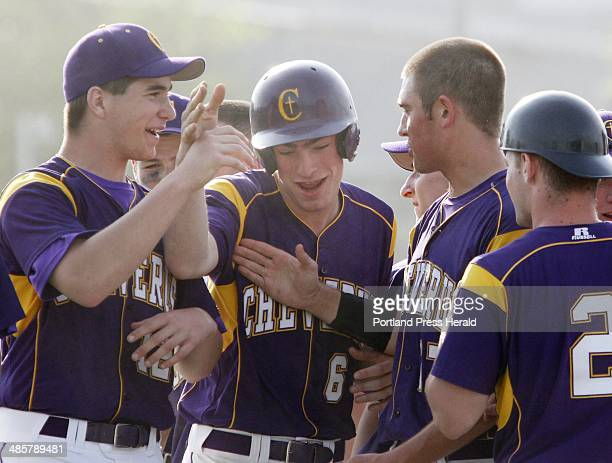 Cheverus vs Westbrook baseball Cheverus teammates celebrate with Peter Gwilym after he tagged and scored on a fly ball by Tyler Flaherty during the...