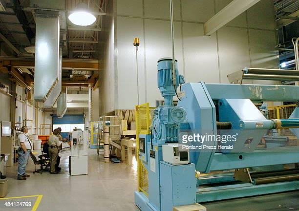 Staff Photo by Derek Davis Friday December 9 2005 Employees work on a coder machine in the ultracast division of Sappi/Warren Fine Paper in Westbrook