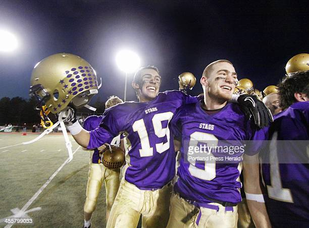 Louis DiStasio left and Peter Gwilym of Cheverus celebrate their victory in the Class A state champioship game at Fitzpatrick Stadium Photographed on...