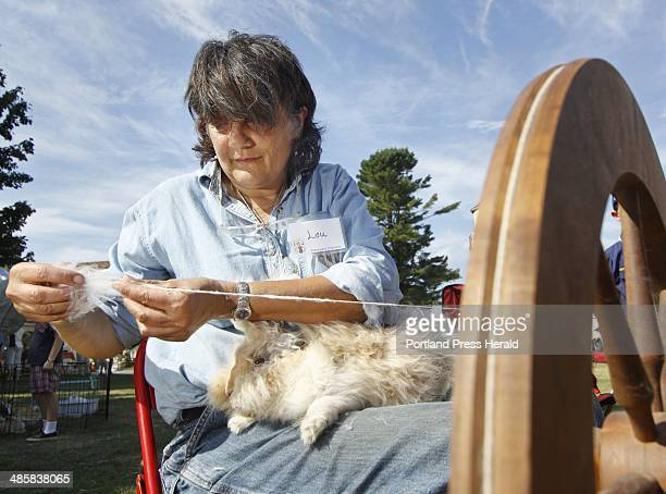Louise Caron of Springvale spins wool from 'Fluffy' an English Angora rabbit at the 8th annual Punkinfiddle festival at the Laudholm Farm in Wells A...