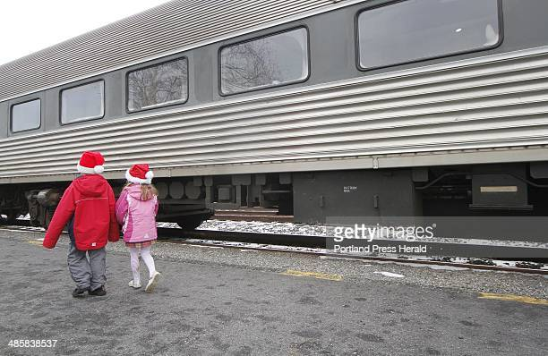MAINE EVENT 5th Annual Candy Cane Train Seth Dixon of Falmouth and Grace McNally of North Yarmouth both 6 head to the train for a ride to Wiscasset...