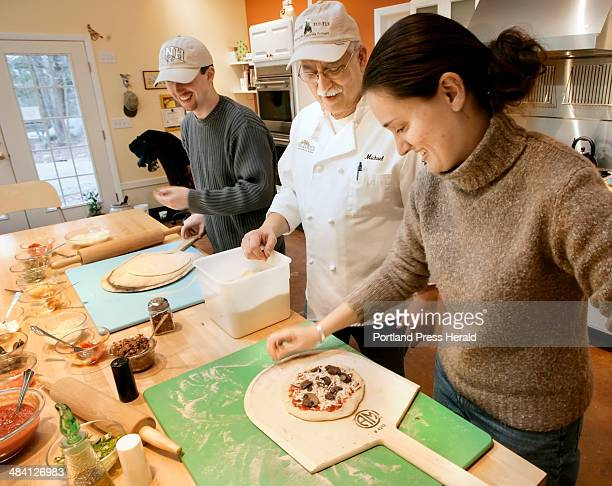 Michael Jubinsky helps TJ McCann and Christine Jamoil of Dover NH make their pizzas at Stone Turtle Baking and Cooking School in Lyman Jan 14 2007...
