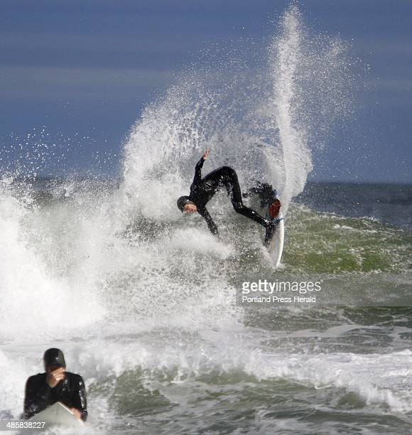 Nico Evans of Cape Neddick spins on a wave while surfing at Short Sands beach in York Photographed on Thursday Oct 14 2010