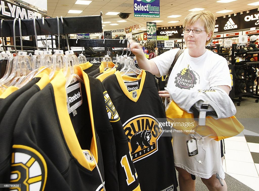 new style f7168 b3b88 People shop for Boston Bruins apparel at the Maine Mall in ...