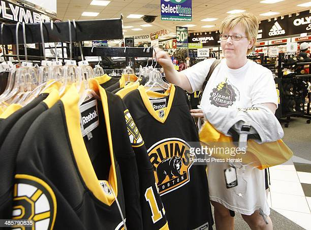 People shop for Boston Bruins apparel at the Maine Mall in South Portland Teresa Tucci of South Portland shops at Olympia Sports Photographed on...