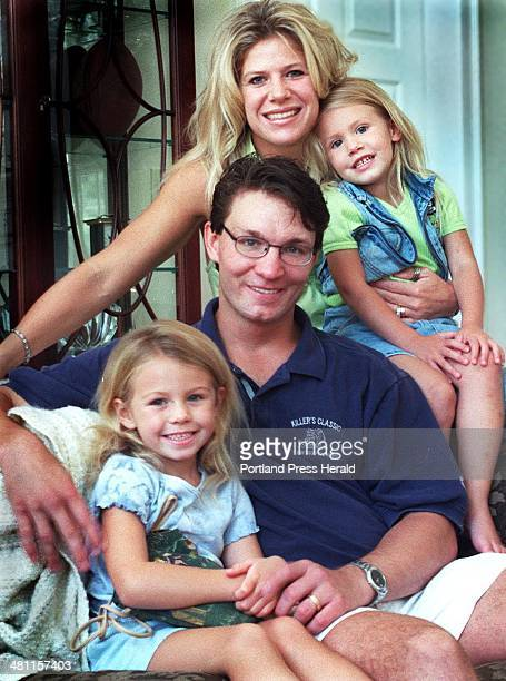 Staff Photo by Doug Jones Fri Aug 11 2000 The Kaminski family Meghan Kevin and their two daughters McKenna and Alexia in the living room of their...