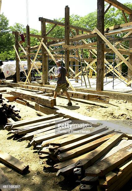 Staff Photo by Doug Jones Fri Jul 20 2001John Courtney at the post and beam barn construction site with support braces salvaged from another barn...