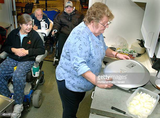 Friday December 7 2007 Barbara Luther Fred Lorfano and Ron Cyr crowd forward to gab with Linda Leclair right as she cooks up a storm for the group of...