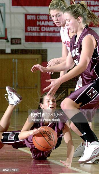 Staff Photo by Doug Jones Monday January 19 2004 Noble's #3 Laurie Fortier goes to the floor after being tripped South Portland's Tricia Millington...