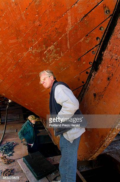 Staff Photo by Doug Jones Monday May 1 2006 Boothbay Shipyard's yard manager Joe Jackimovicz pauses under the bow of the Bounty where the stem which...
