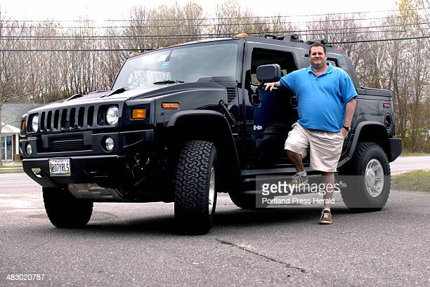 Staff Photo by Doug Jones Monday May 9 2005 Nick Gennaro and his '05 Hummer for Ray's car personalities