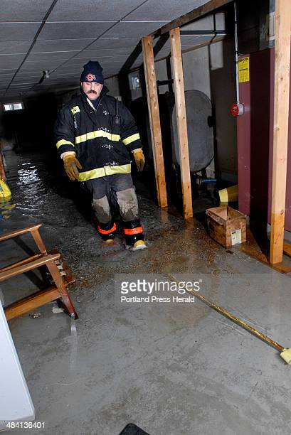 Staff photo by Doug Jones Tuesday April 10 2007 Louis Anderson a volunteer with the Buxton police/fire Department checked the sump pump in Joan...