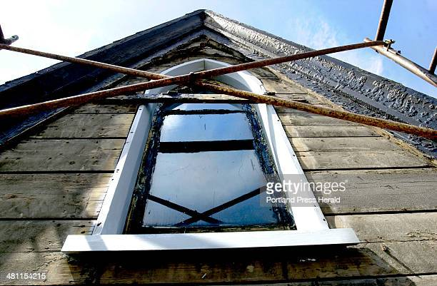 Staff Photo by Doug Jones Tuesday August 20 2002 A dormer window at the St Paul's Rectory with its frame restored is surrounded by pine boards with a...