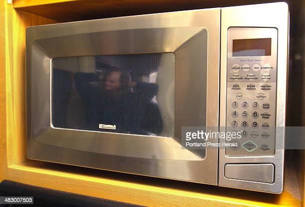 Staff Photo by Doug Jones Tuesday March 22 2005 Ted Musgrave's fifties microwave and dishwasher crown the appliances in his birch plywood cabinetted...