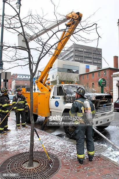 Staff photo by Doug Jones Wednesday April 25 2007 Mike Tocher a city employee was helped from the bucket of his burning cherry picker truck by...