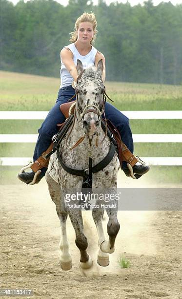 Staff Photo by Doug Jones Wednesday August 22 2001 Shanna Fuller 19 year old horse woman extrodinair puts her Appaloosa 'Charge it to Kobe' through...