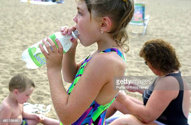 Staff Photo by Faith Cathcart Thursday August 15 2002 Lindsey Day of Otisfield goes for a refreshing guzzle at Weston's Beach on the Saco River in...