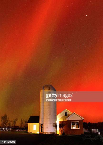 Staff Photo by Fred J Field Friday October 31 2003 A 30second exposure reveals the Northern Lights dancing above Valley Farm at Pineland in New...