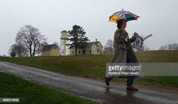 Staff Photo by Fred J Field Sunday April 24 2005 Deborah Danforth of Kennebunk kept heavy rain at bay as she left the Earth Day Celebration at...