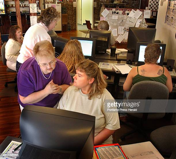 Staff Photo by Fred J Field Thu Jun 06 2002 Peer support worker Louise Dulac of DoverFoxcroft left helps former Dexter shoe worker Donna Stewart of...