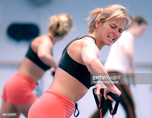 Staff Photo by Fred J Field Thursday January 6 2005 Aerobics instructor Liz Caldwell of South Portland leads an intense cardiovascular workout at...