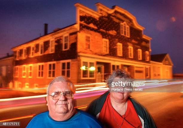 Staff Photo by Fred J Field Thursday May 9 2002Lubec traffic passes in the night as Raymond Moores and his sister Debra Moores recall the 57years of...