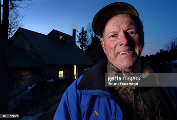 Staff Photo by Fred J Field Wed Mar 19 2003 Outside the sugarhouse at dusk Rodney Stacey of Parsonsfield has a smile as he recalls the sweet seasons...