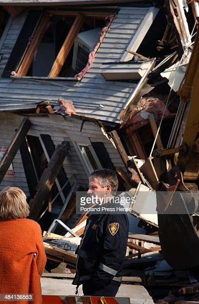 Staff Photo by Fred J. Field, Wednesday, October 20, 2004: Saco Fire Chief Alden Murphy fielded questions amid the destruction following an explosion...