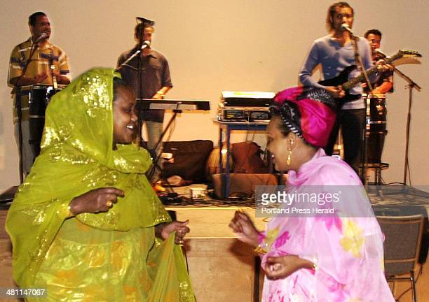 Staff Photo by Gordon Chibroski Friday June 22 2001 Dressed in colorful Somalian dress Hawa Anshur and Indonesia Maye dance to the more contemporary...