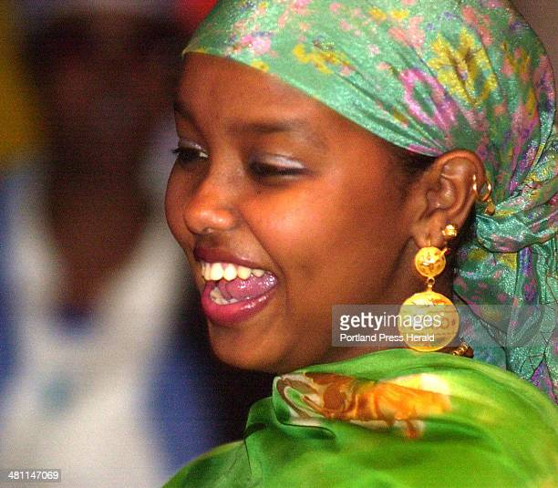 Staff Photo by Gordon Chibroski Friday June 22 2001 Faiza Hassah is dressed in traditional Somalia festival colors as she enjoys dancing to the Shega...