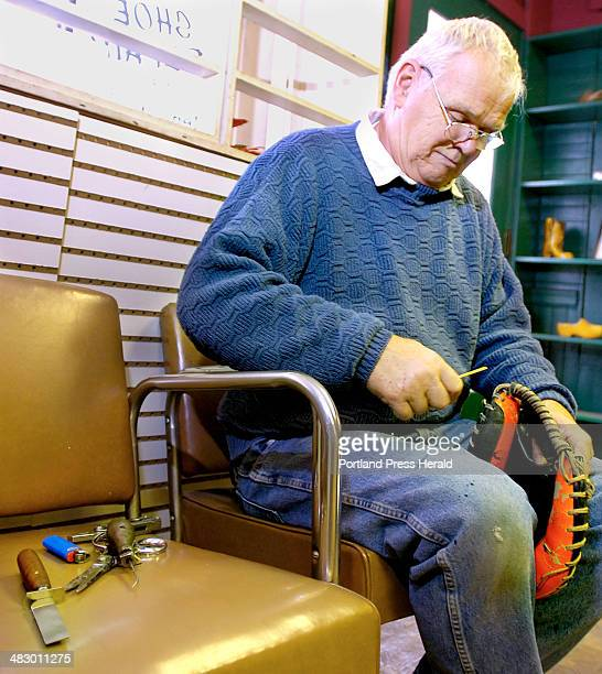 Staff Photo by Gordon Chibroski Friday March 10 2006 Steve Lentz owner of Roy's Shoe Shop in Deering Center on Stevens Ave finds time to repair an...