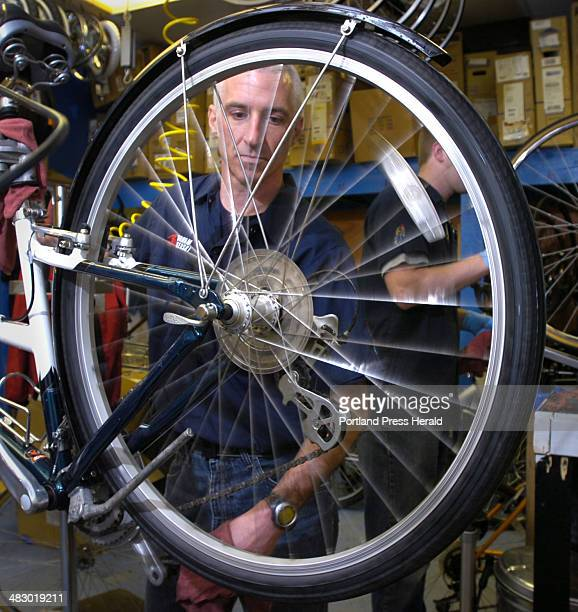 Staff Photo by Gordon Chibroski Friday May 12 2006 Tim Corcoran Manager of the Gorham Bike and Ski shop on Congress St outer Portland prepares a...