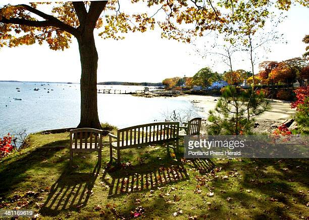Staff Photo by Gordon Chibroski Mon Oct 29 2001 Shadows are cast by these hardwood benches on the point of Casco Terrace in Falmouth the view is of...