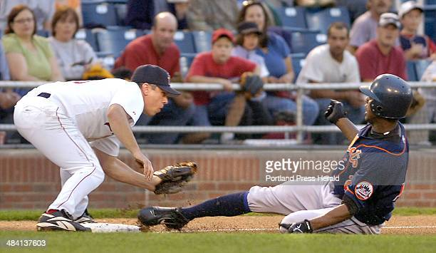 Staff Photo by Gordon Chibroski Monday August 21 2006 Mets runner Ambriorix Concepcion slips under the tag of Sea Dog's third baseman Brian Myrow as...