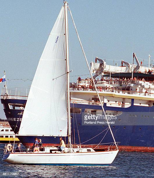 Staff Photo by Gordon Chibroski, Thursday, July 20, 2000: The Solstice, a 32 foot cruising sailboat, under direction of Albert Kilodgi, a sailing...