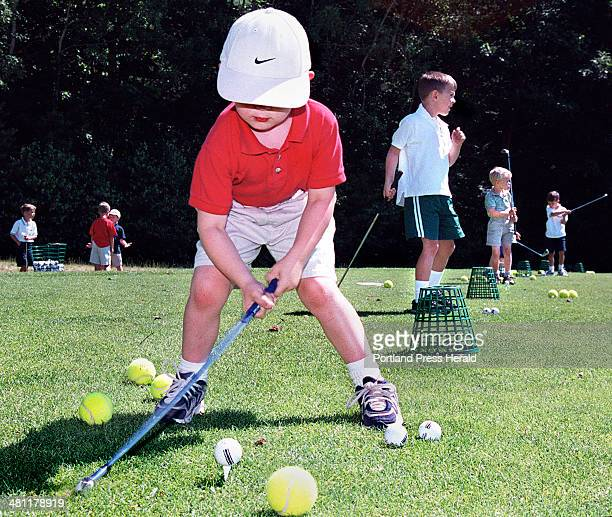 Staff Photo by Gordon Chibroski Thursday July 6 2000 Alex Lange Cumberland takes his first swing at a real golf ball after practicing with the much...