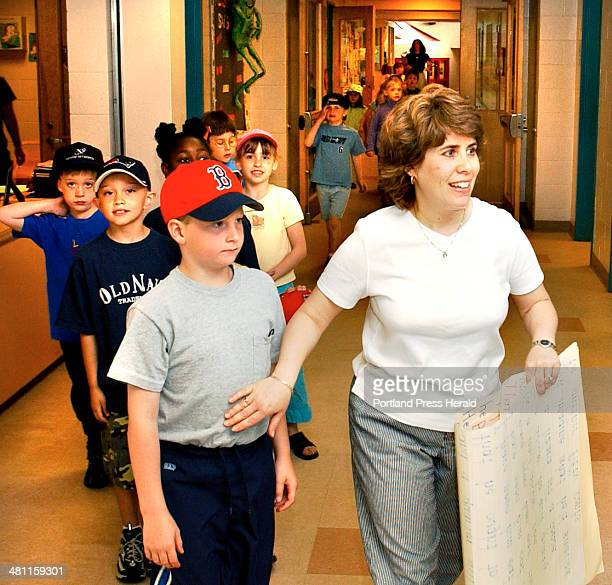 Staff Photo by Gordon Chibroski Thursday June 5 2003 Lori Bloom teacher at the Blue Point Primary School in Scarborough takes her class to gym with...
