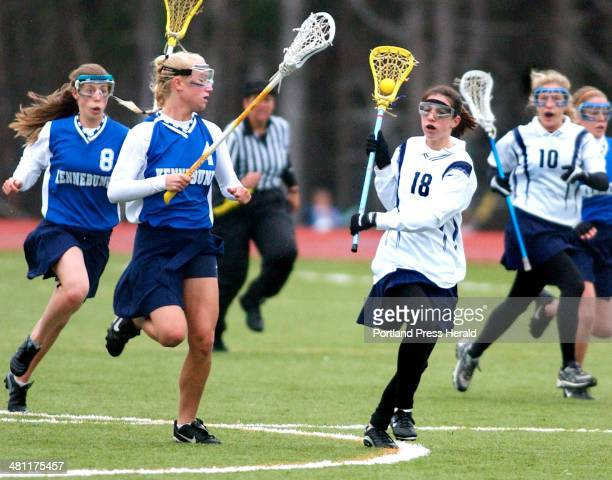 Staff Photo by Gordon Chibroski Thursday May 1 2003 YARMOUTH'S Alexa Sansore races down field on a fast break with Kennebunk's Jesse Merrill and...