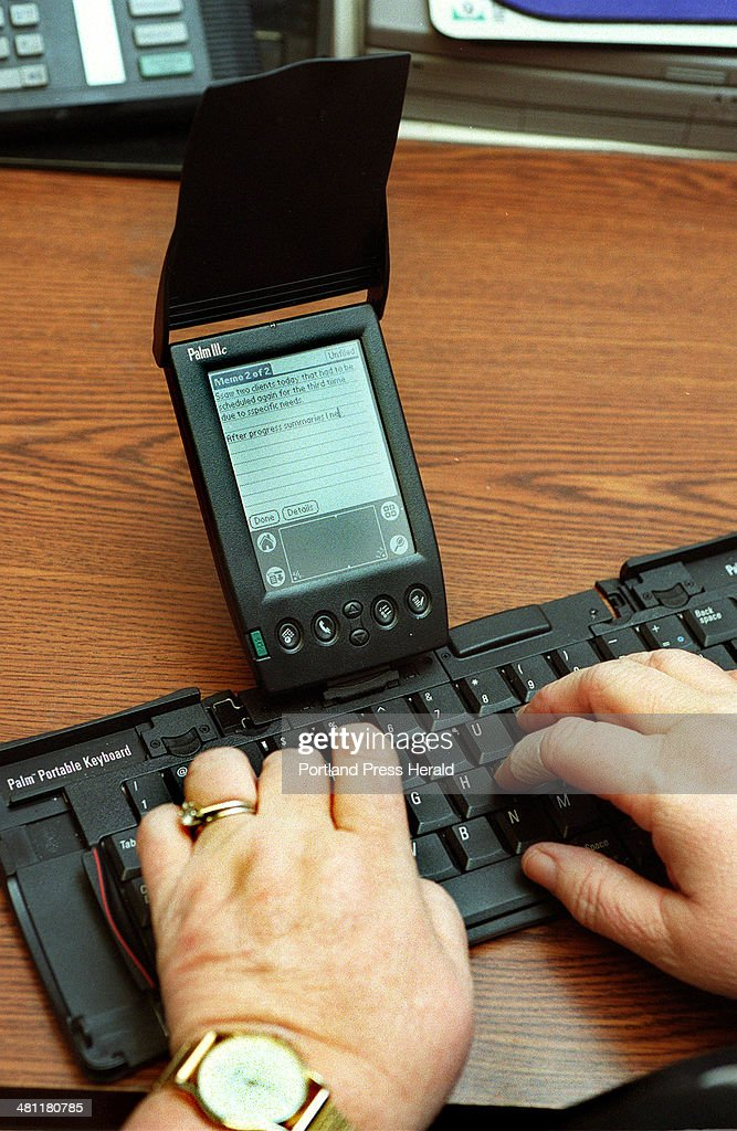 Staff Photo by Gordon Chibroski, Tue, Apr 17, 2001: A Palm Pilot has replaced the daily diary Bev Bryant has used for years to help her deal with a forgotten situation but the function is the same. Plus it helps her organize her day and write memos to business associates.