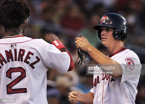 Staff Photo by Gordon Chibroski Tuesday August 16 2005 Jeremy West gets kudos from teammate Hanley Ramirez after scoring a run in the sixth inning