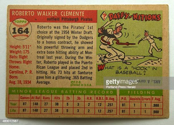 Staff Photo by Gordon Chibroski Tuesday August 31 2004 Roberto Clemente 1955 Topps Card reverse