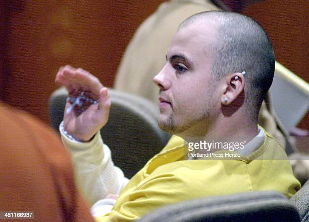 Staff Photo by Gordon Chibroski Tuesday February 12 2002 Jeffrey Gorman waves to an acquaintance after being brought into Superior Court in Portland...