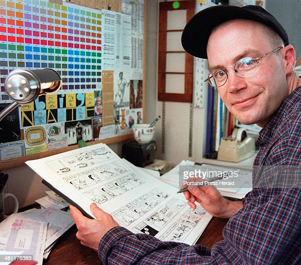 Staff Photo by Gordon Chibroski Tuesday July 11 2000 Lincoln Peirce of Portland works on his cartoon strips in an office at his home He will have a...