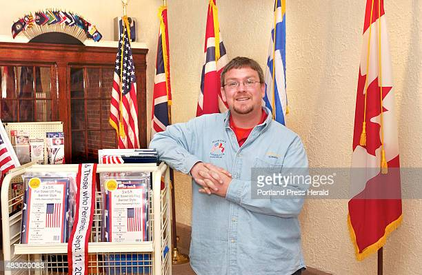 Staff Photo by Gordon Chibroski Tuesday May 11 2004 Ed Simpson is surrounded with flags and related items in his new shop in Biddeford Based out of...