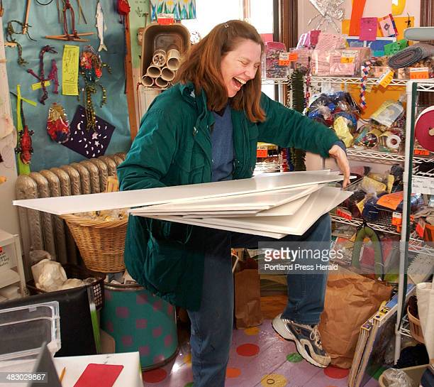 Staff Photo by Gordon Chibroski Wednesday April 7 2004 Lori Austill has trouble holding on to a mess of styrofoam panels she uses to back her artwork...