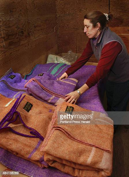Staff Photo by Gordon Chibroski Wednesday December 31 2003 Nanney Kennedy arranges her assortment of original blankets she designed inspired from an...