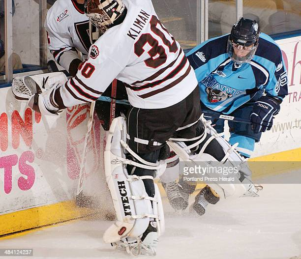 Staff Photo by Gordon Chibroski Wednesday December 7 2005 Brown's goalie #30 Kevin Kliman gets caught behind his goal as UMaine Vince Laise tries to...